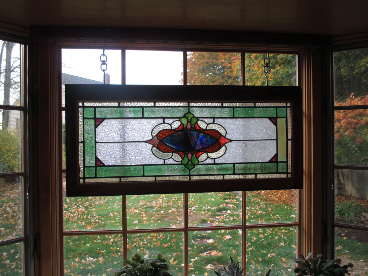 Antique stained glass transom window refinished for Transom windows