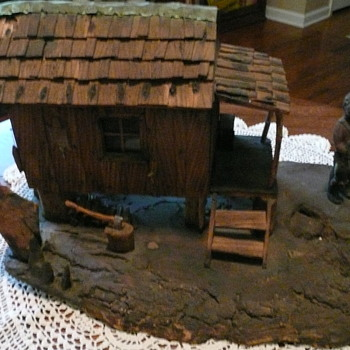 Carved cabin scene