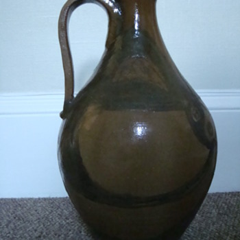 Huge handled jug, signed