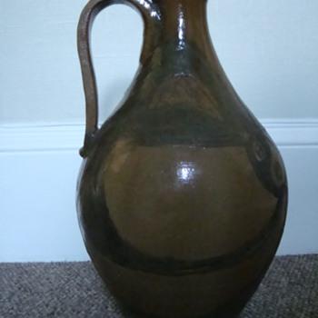 Huge handled jug, signed