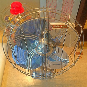 1950s era table top or mounted electric chrome fan
