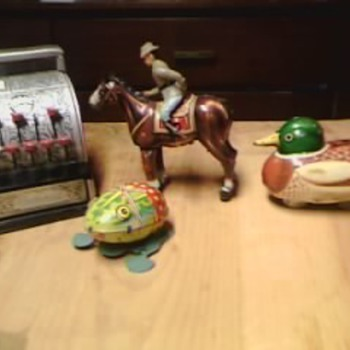Collection of wind up Tin toys