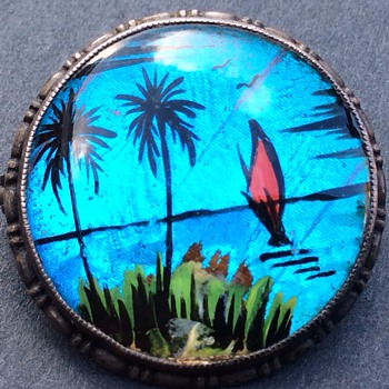 Reverse painted brooch