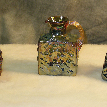 Rare Pilgrim Glass iridized hand mould blown applied handles.