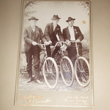 Cabinet card of three Wisconsin bicycle riders c. 1890s