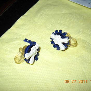 earrings with a salior that looks like the cracker jack guy.