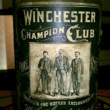 WINCHESTER CHAMPION CLUB WHISKEY BOTTLE