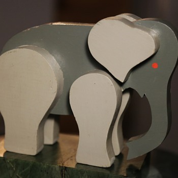 Midcentury Elephant?  very simple and elegant.