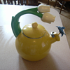 Teakettle with tulips and hummingbird