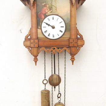 One of my favorite antique cuckoo clocks.  1850's Beha tin plate cuckoo featuring the sackingen Trumpeter!