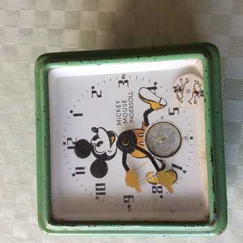My early metal Mickey clock