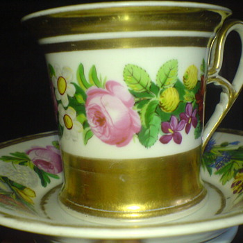 An old china cup , hand painted and elegant romantic design