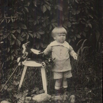 VINTAGE PHOTO UNHAPPY BOY WITH TOYS.BUSTER BROWN HAIRCUT and SUIT!