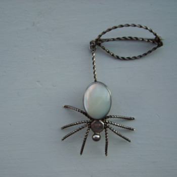 silver spider brooch bought recently