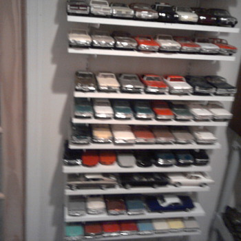 Shelf of promo cars...