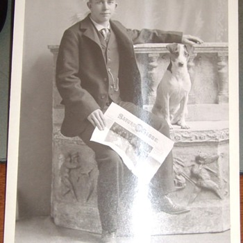 Cabinet card of man with dog and newspaper