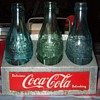 C. 1950's Coca Cola 6 bottle aluminum carrier...
