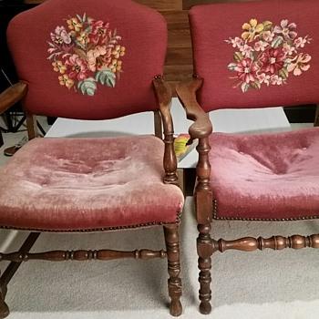 Burgundy velvet chair with needlepoint backs.