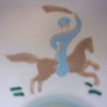 Porcelain Bowl,  Handpainted Figure of Arab on Horse with Sword.  Faience? Any Guesses?