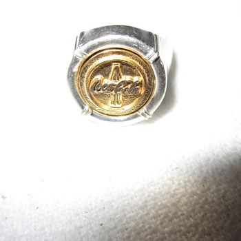 Found a silver and gold coke ring - Coca-Cola