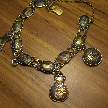 Unknown antique charm bracelet