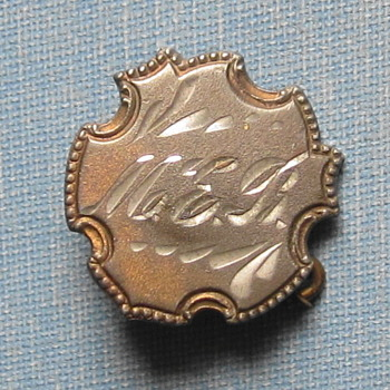 Antique Pin appears to be silver.