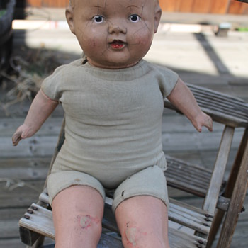Baby Doll soft body with plaster? head/arms/legs.