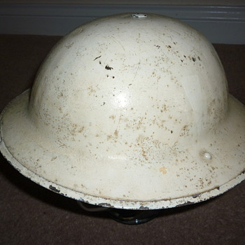 WW1 and WW11 helmet. Rare British winter cammo