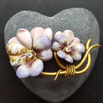 Wounded enamel and gold pansies brooch, part 1.
