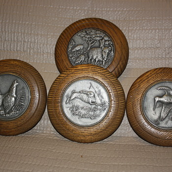 Pressed metal animal tokens encased in wood