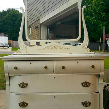 Antique dresser with decorative face above mirror - Furniture