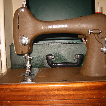 International Sewing Machine and the box of attachments - Sewing