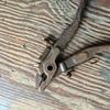 Strange pliers