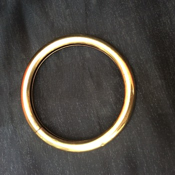 Metal Bangle/Bracelet with three balls inside hollow rim