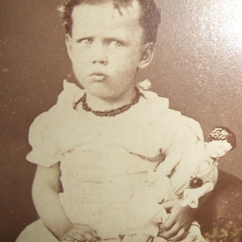 CDV of child with China Head doll - Photographs