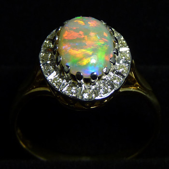 Bright Crystal Opal Ring with a Halo of Diamonds