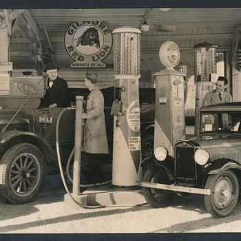 Photo of Older Autos Fueling up with Gilmore Gasoline - Photographs