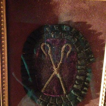 A badge of unknown origin.