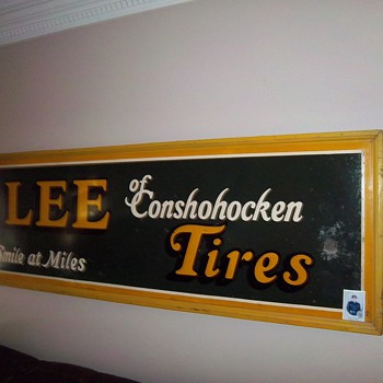 old lee tire tin sign