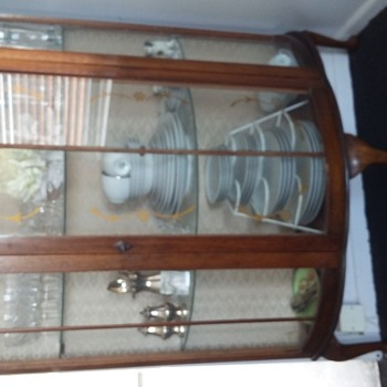 Antique  curved glassed China Cabinet with 3 queen anne legs