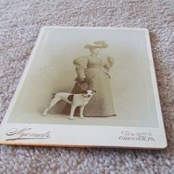 Cabinet card of woman with dog c. 1885