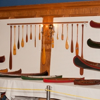 antique model canoe, kayak and miniature paddle displays