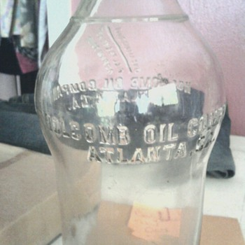 Holcomb Oil bottle
