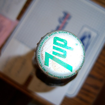 Old Coco Cola bottle with 7UP cap