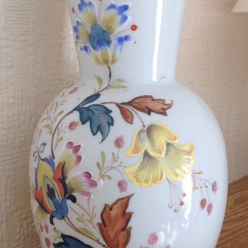 Large white glass decorated vase.