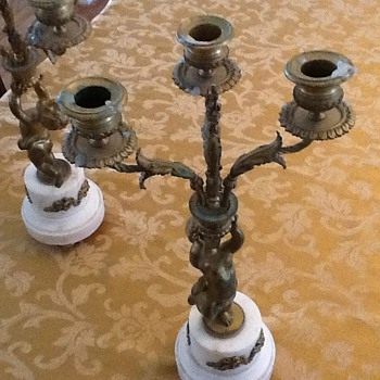 Gilt bronze and marble putti candelabra's