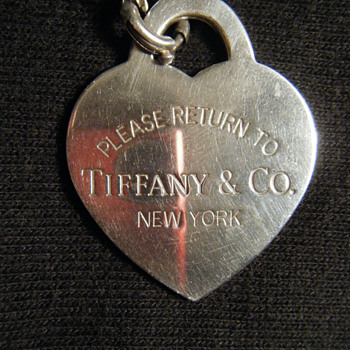 TIFFANY STERLING SILVER CHARM-MARKED 925