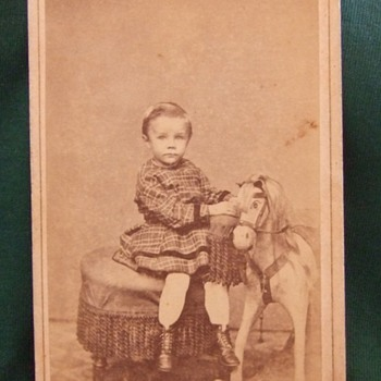 CDV of boy in dress with rocking horse - Photographs