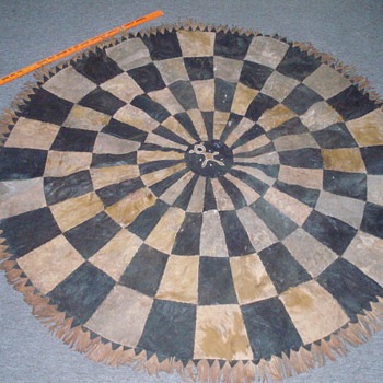Patched cowhide circle w/ fringe???? - Native American