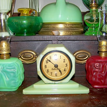 Vidrio Cadillac Clock flanked by two small Pittsburgh satin glass oil lamps